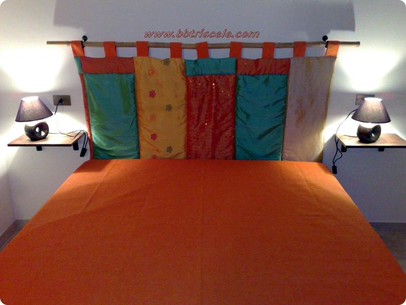 triscele stanza arancio letto.jpg