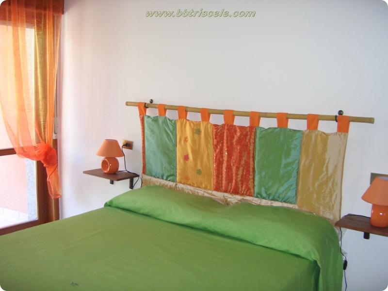 triscele stanza smeraldo letto.jpg